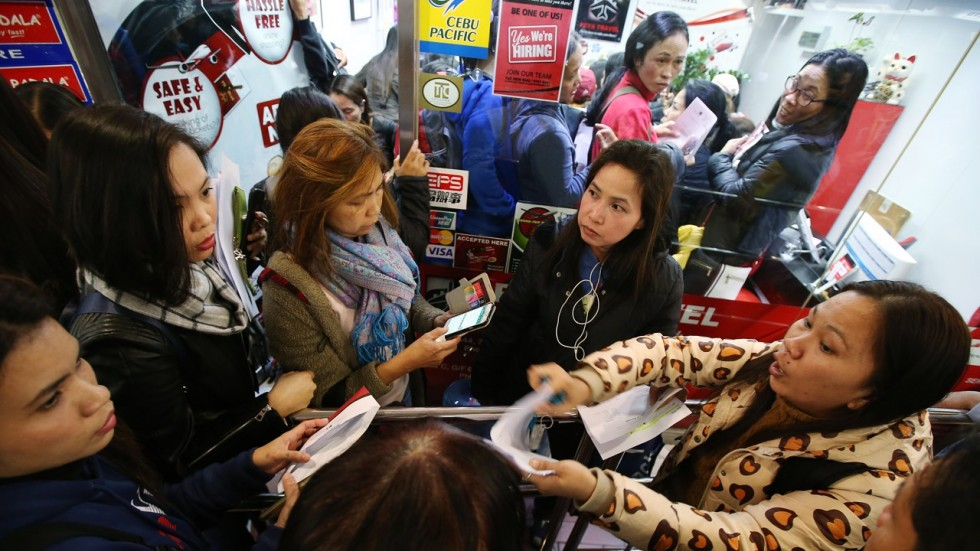 OFWs who are stranded in Hong Kong will now return to their loved ones. [Image Credit: Phil Star]