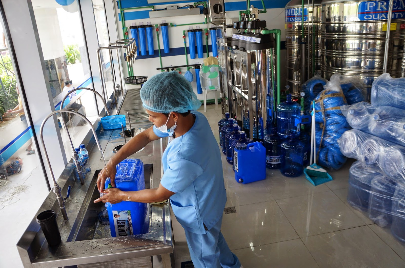 A water refilling station is a profitable business for any OFW. [Image Credit: Wazzup Pilipinas]