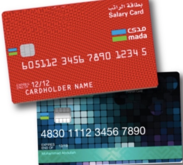 Prepaid salary cards ensure that workers receive their salary on time. [Image Credit: Arab News]